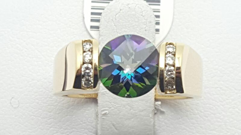 Blue Topaz Lady's Stone & Diamond Ring 8 Diamonds .16 Carat T.W.