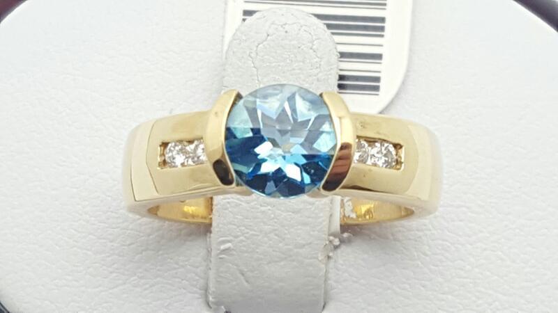 Blue Topaz Lady's Stone & Diamond Ring 4 Diamonds .16 Carat T.W.