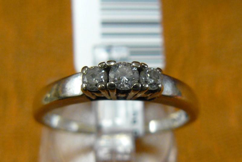 Lady's Diamond Fashion Ring 3 Diamonds .15 Carat T.W. 14K White Gold 1.5dwt