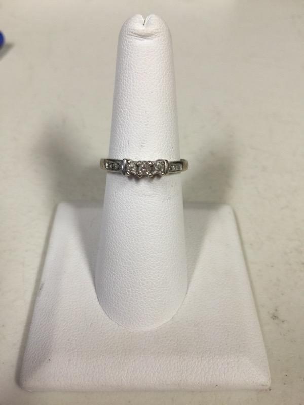 Lady's Diamond Wedding Band 9 Diamonds .31 Carat T.W. 10K White Gold 2g