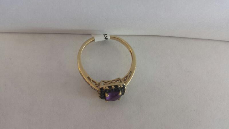 10k Yellow Gold Ring with Purple Stone, 12 Black Stones, and 2 White Stones