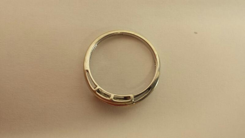 Lady's Diamond Fashion Ring 5 Diamonds .15 Carat T.W. 10K White Gold 0.9dwt