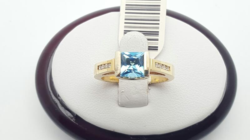 Blue Topaz Lady's Stone & Diamond Ring 6 Diamonds .12 Carat T.W.