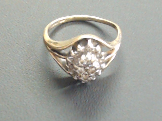 Lady's Diamond Cluster Ring 18 Diamonds .22 Carat T.W. 10K Yellow Gold 2.4g