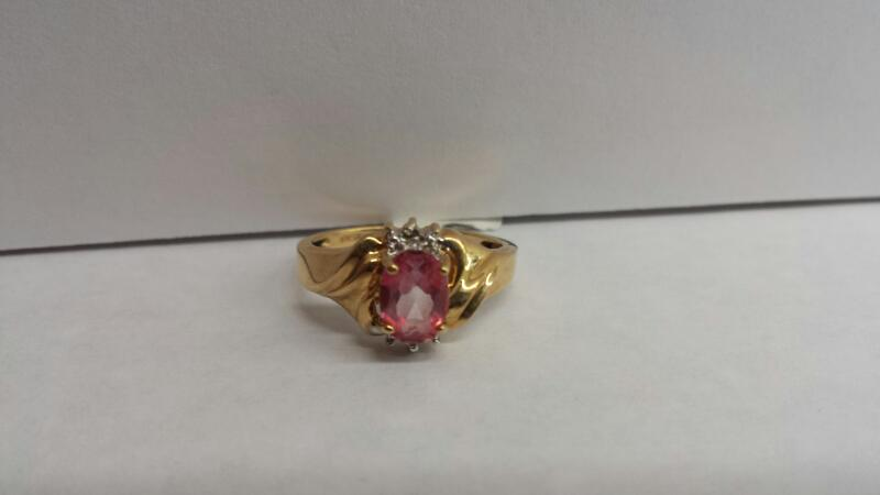 10k Yellow Gold Ring with 1 Pink Stone and 6 Diamond Chips