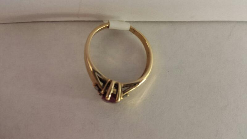 10k Yellow Gold Ring with 1 Red Stone and 6 Diamond Chips