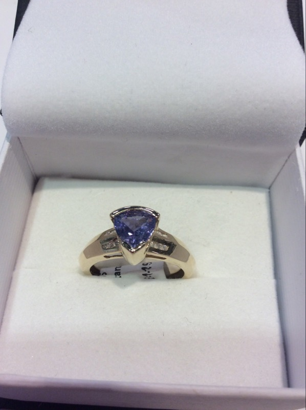 Synthetic Tanzanite Lady's Stone & Diamond Ring 12 Diamonds .060 Carat T.W.