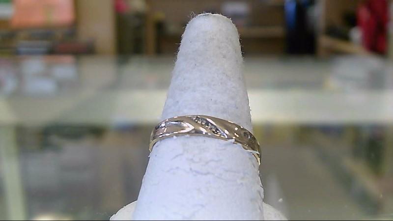 Lady's Diamond Wedding Band 3 Diamonds .06 Carat T.W. 10K Yellow Gold 1.6g