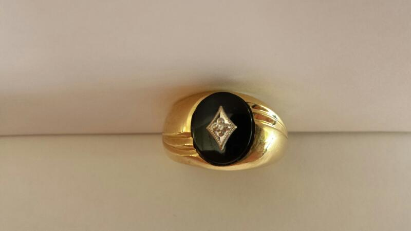 10k Yellow Gold Ring with Black Oval Stone and 1 Diamond Chip