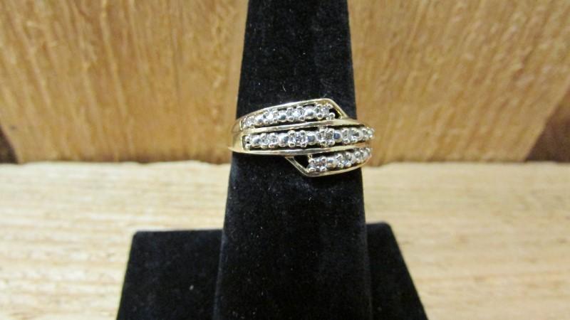 Lady's Diamond Fashion Ring 13 Diamonds 0.13 Carat T.W. 10K Yellow Gold 2.4g