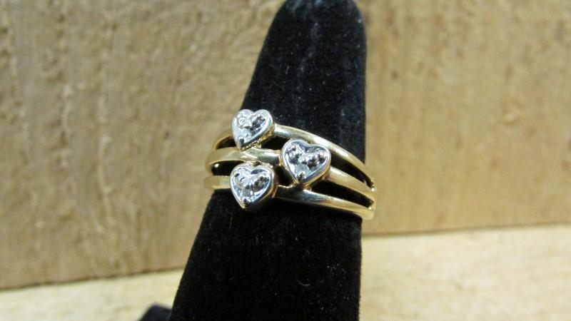 Lady's Diamond Fashion Ring 3 Diamonds 0.03 Carat T.W. 10K Yellow Gold 2.4g