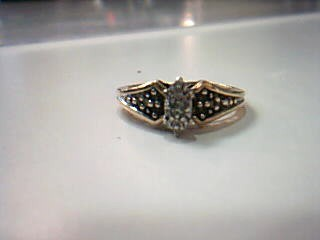Lady's Diamond Fashion Ring 12 Diamonds .12 Carat T.W. 10K Yellow Gold 2.7g
