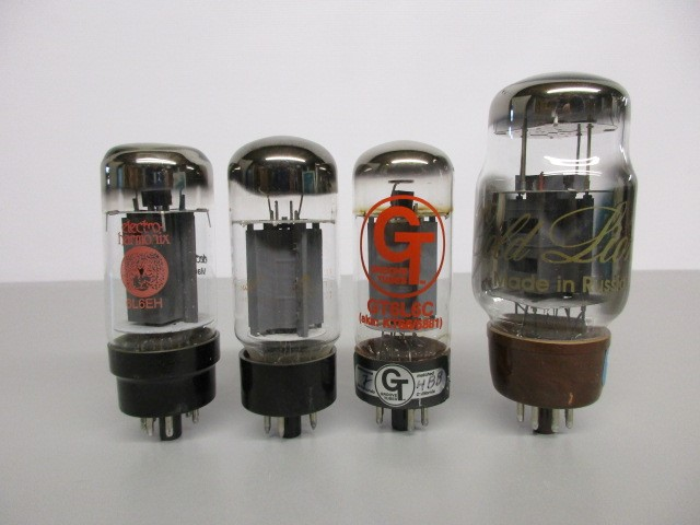 LOT OF FOUR (4) 6L6 TYPE POWER TUBES. TEST GOOD.