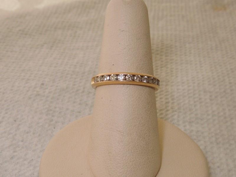 Lady's Diamond Wedding Band 12 Diamonds .36 Carat T.W. 14K Yellow Gold 3.1g