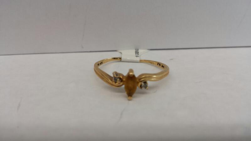 10k Yellow Gold Ring with 1 Yellow Stone and 2 Diamond Chips