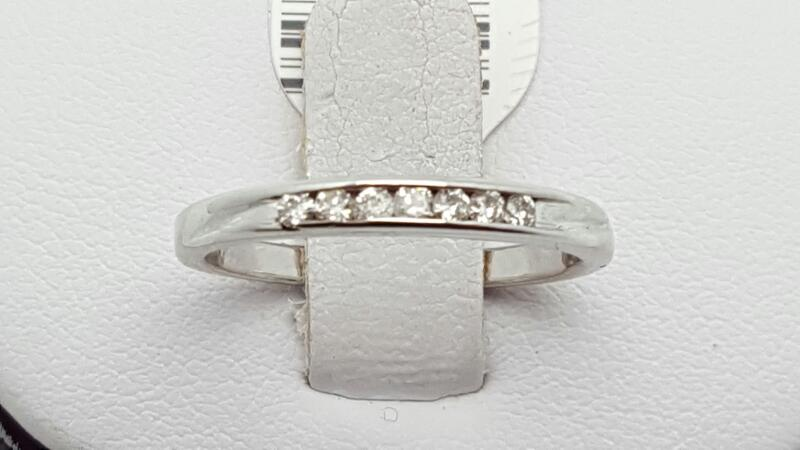 Lady's Gold-Diamond Anniversary Ring 7 Diamonds .14 Carat T.W. 14K White Gold