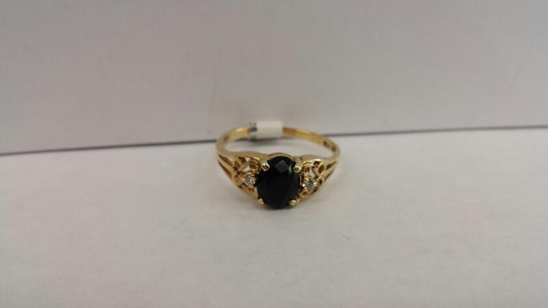 14k Yellow Gold Ring with 1 Black Stone and 2 Diamond Chips