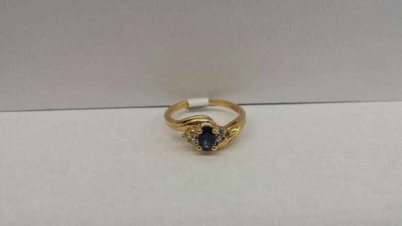 14k Yellow Gold Ring with 1 Blue Stone and 6 Diamond Chips