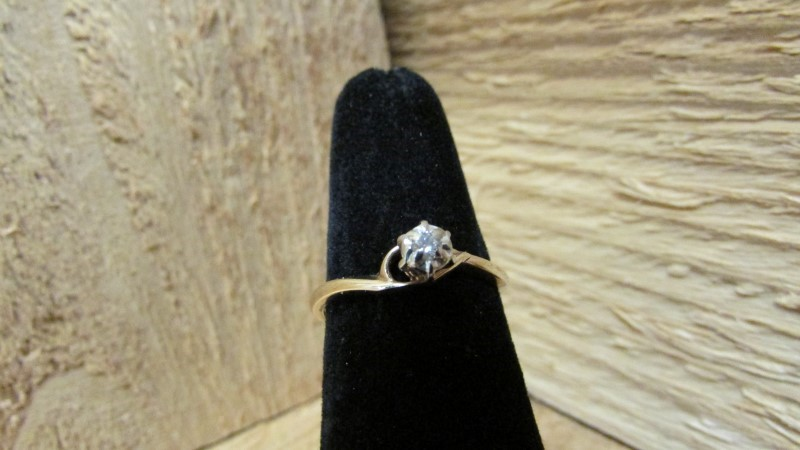 Lady's Diamond Solitaire Ring .06 CT. 10K Yellow Gold 1.7g Size:6.8