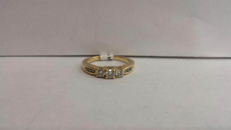 14k Yellow Gold Ring with 3 Diamonds and 6 Diamond Chips