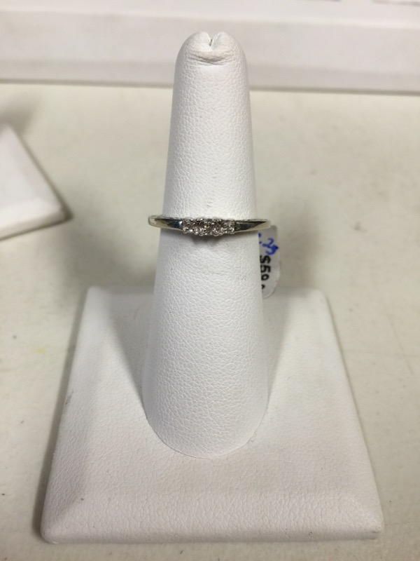 Lady's Diamond Solitaire Ring 3 Diamonds .09 Carat T.W. 10K White Gold 1.5g