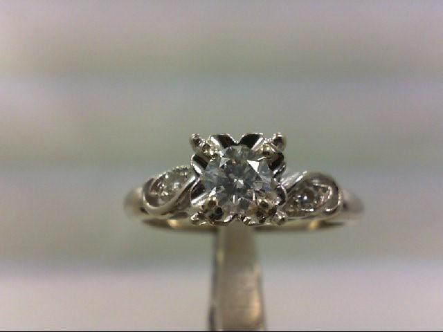 Lady's Diamond Engagement Ring 3 Diamonds .39 Carat T.W. 14K Yellow Gold 9g
