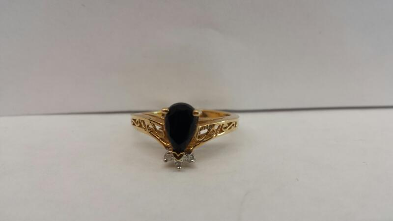 10k Yellow Gold Ring with 1 Black Stone and 3 Diamond Chips