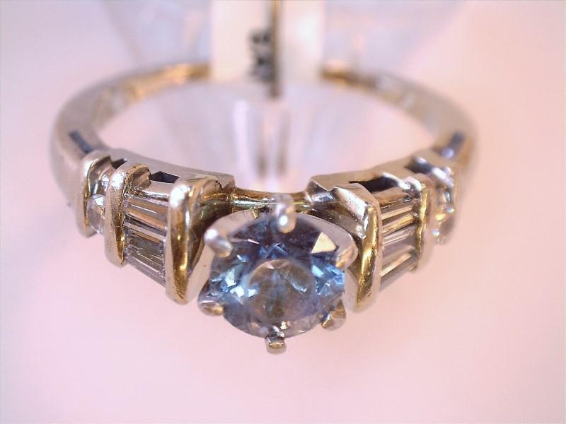 Sapphire Lady's Stone & Diamond Ring 8 Diamonds .24 Carat T.W. 14K White Gold