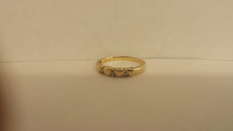 Lady's Diamond Fashion Ring 9 Diamonds .09 Carat T.W. 10K Yellow Gold 1.4dwt