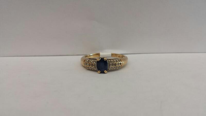 10k Yellow Gold Ring with 1 Blue Stone and 24 Diamond Chips