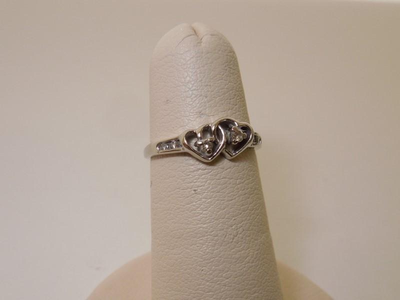 Lady's Diamond Fashion Ring 6 Diamonds .06 Carat T.W. 10K White Gold 1.3g