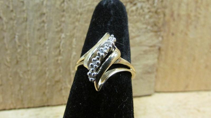 Lady's Diamond Fashion Ring 5 Diamonds 0.05 Carat T.W. 10K Yellow Gold 2.2g
