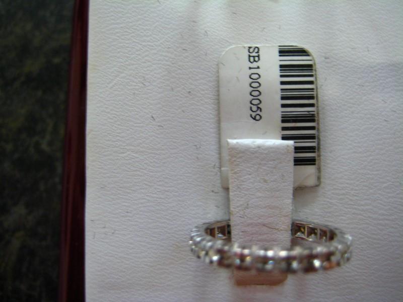 Lady's Gold-Diamond Anniversary Ring 0.01 CT. 14K White Gold 1.8g