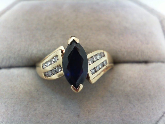 Sapphire Lady's Stone & Diamond Ring 16 Diamonds .32 Carat T.W. 10K Yellow Gold