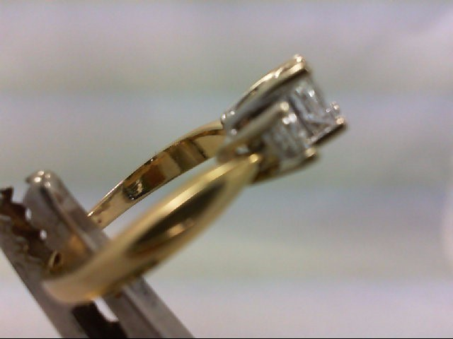 Lady's Diamond engagement ring 3 Diamonds 1.00 Carat T.W. 14K Yellow Gold 3.78g