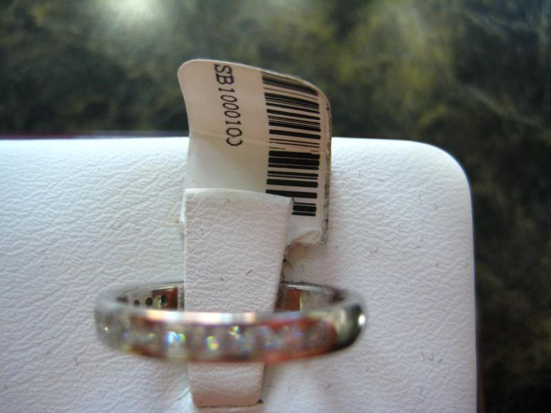Lady's Gold-Diamond Anniversary Ring 0.01 CT. 14K White Gold 2.9g