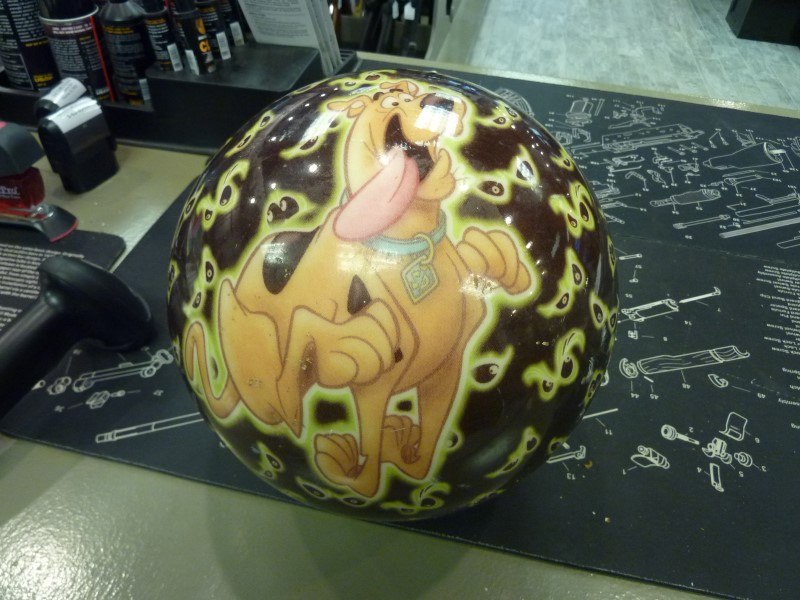 UNDRILLED SCOOBY DOO BOWLING BALL.