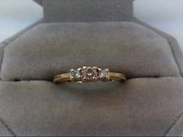 Lady's Diamond Wedding Band 3 Diamonds .23 Carat T.W. 14K Yellow Gold 2.6g
