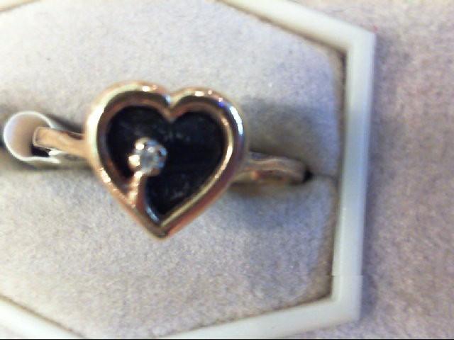 Lady's Diamond Fashion Ring .01 CT. 10K Yellow Gold 1.8g