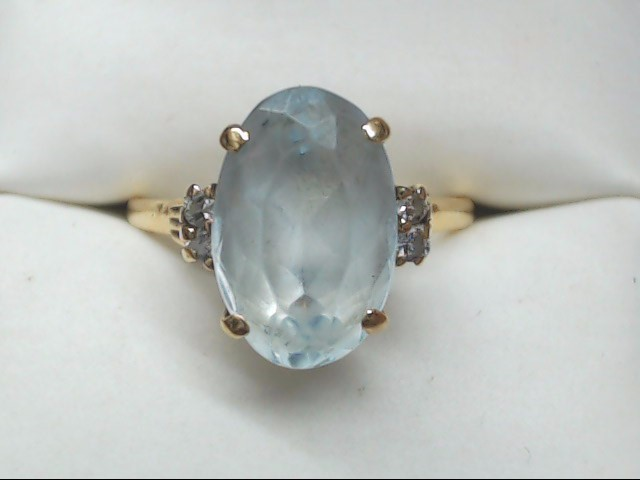 Blue Stone Lady's Stone & Diamond Ring 4 Diamonds .16 Carat T.W.