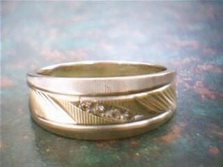 Lady's Diamond Wedding Band 4 Diamonds .04 Carat T.W. 14K Yellow Gold 5.2g