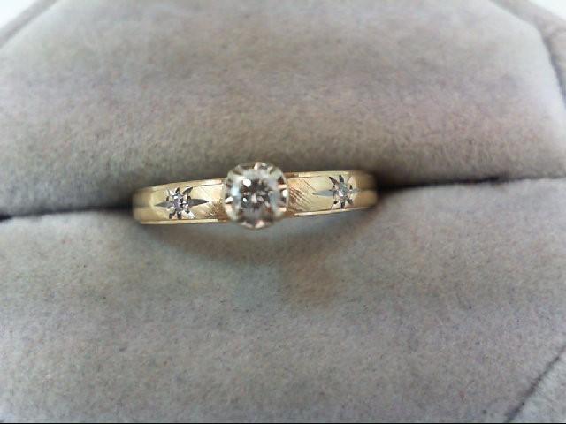Lady's Diamond Engagement Ring 3 Diamonds .12 Carat T.W. 14K Yellow Gold 2.3g
