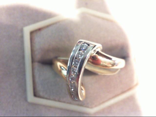 Lady's Diamond Fashion Ring 7 Diamonds .13 Carat T.W. 14K 2 Tone Gold 4.2g