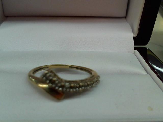 Lady's Diamond Cluster Ring 8 Diamonds .16 Carat T.W. 10K Yellow Gold 1.6g