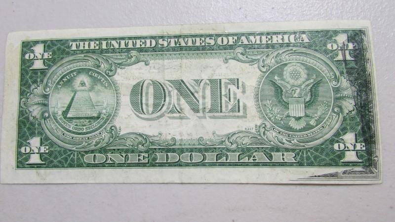 1935 E OFFSET SILVER DOLLAR