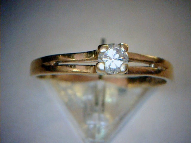 Lady's Diamond Solitaire Ring .18 CT. 14K Yellow Gold 1.2dwt Size:8