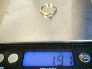 Lady's Diamond Solitaire Ring .10 CT. 14K Yellow Gold 1.8g