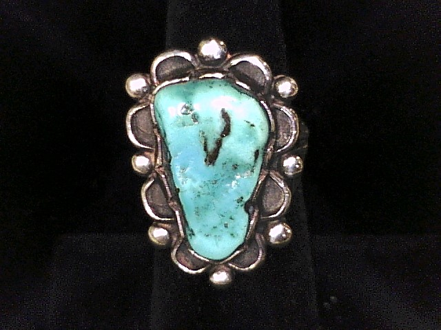 """5.5 RING SIZE TURQUOISE STONE MEASURING 1""""X0.5"""" AT WIDEST AREA STERLING SILVER"""