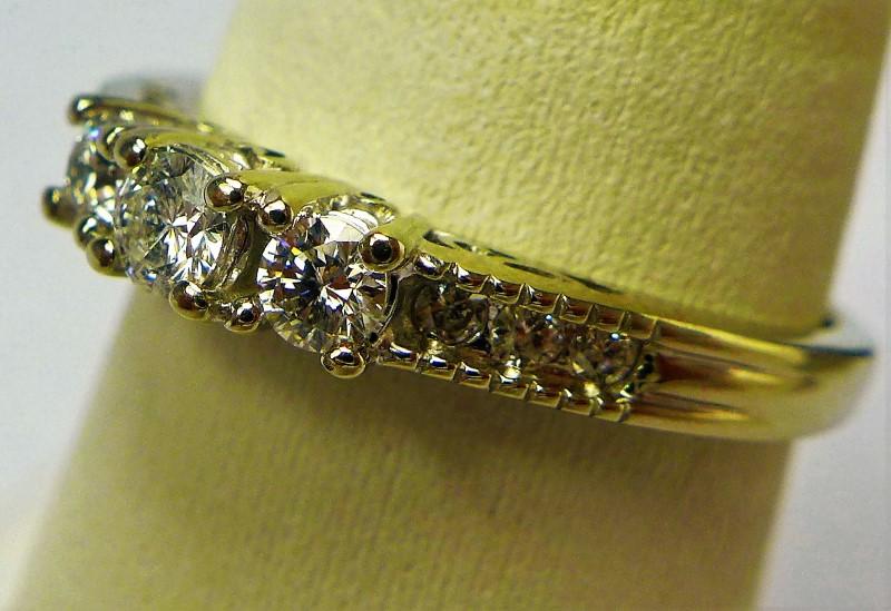 Lady's Diamond Fashion Ring 9 Diamonds .41 Carat T.W. 14K White Gold 3.5g