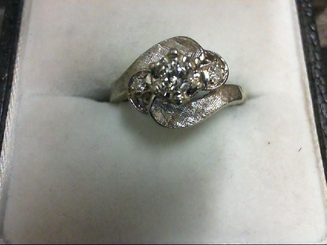 Lady's Diamond Fashion Ring 3 Diamonds 0.17 Carat T.W. 14K White Gold 2.9g